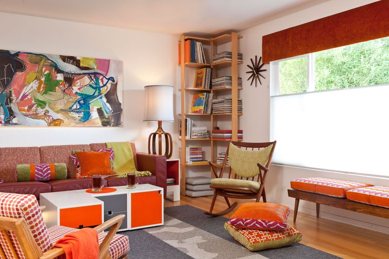 a midcentury modern style living room with a corner bookshelf.