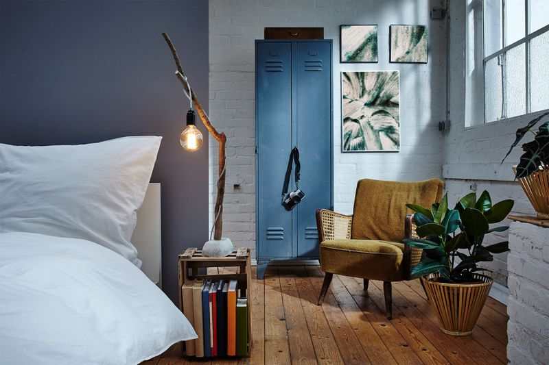 A retro-style metal locker adds storage in a bedroom.