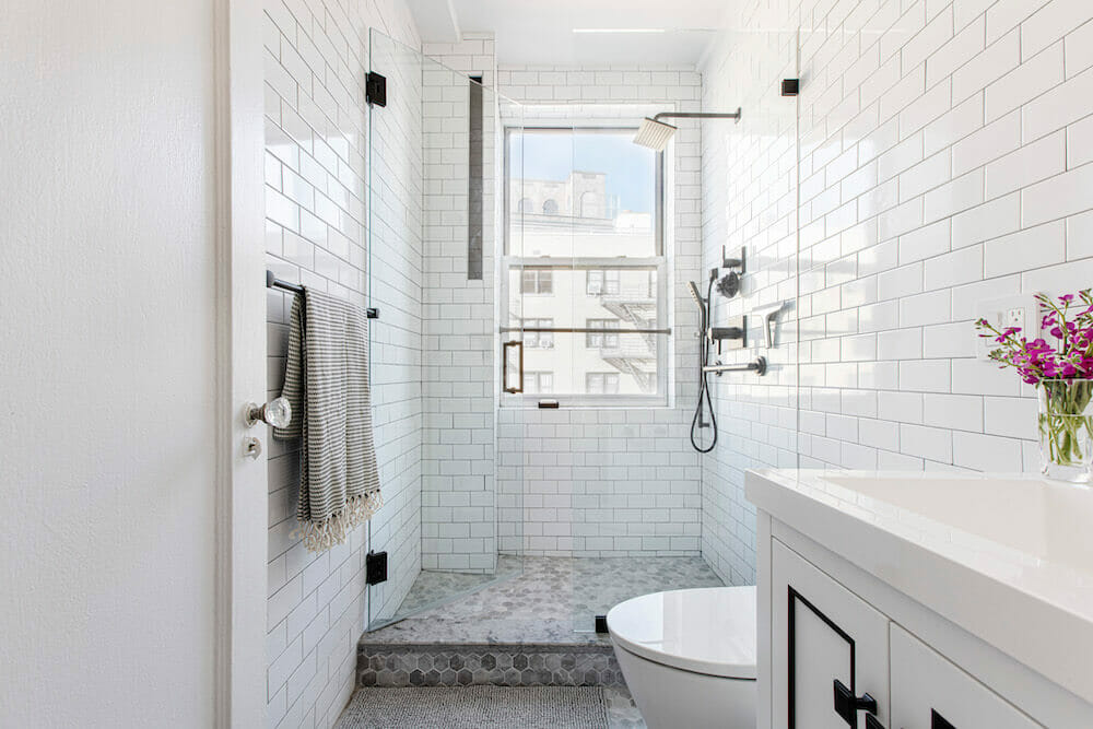 Image of a white bathroom with subway tile and walk-in shower