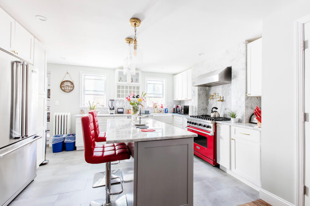 Kitchen with kitchen island, quartz countertops, and high-backed chair seating