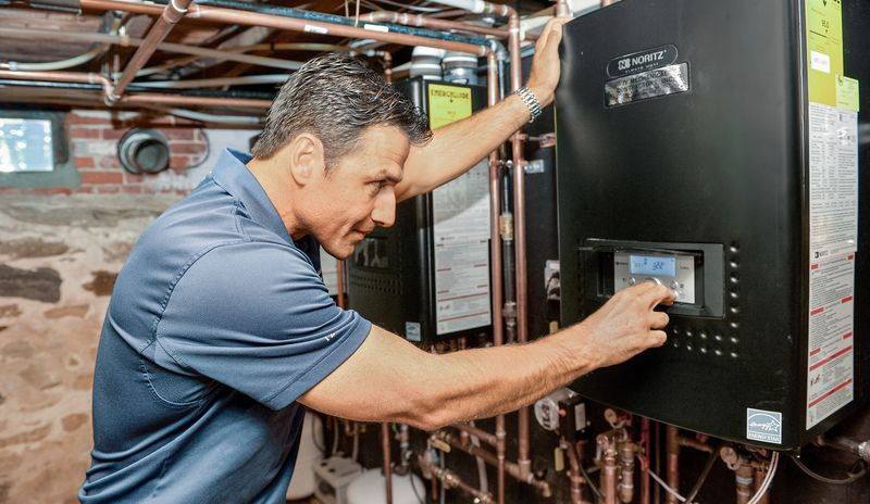 Man Sets Noritz Tankless Water Heater